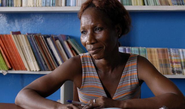 Martha Sipply, a teacher at N.V. Massaquoi School preparing her lessons in the n